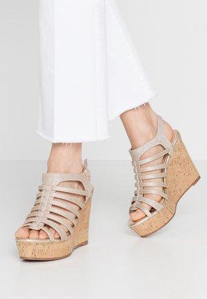 High heeled sandals - glitter light gold