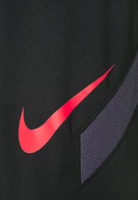 Nike Performance - STRIKE PANT  - Tracksuit bottoms - black/dark raisin/siren red - 2
