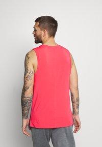 Nike Performance - TANK  - Camiseta de deporte - light fusion red/black - 2