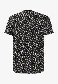 Calvin Klein Jeans - PALM TEE - Print T-shirt - black - 1