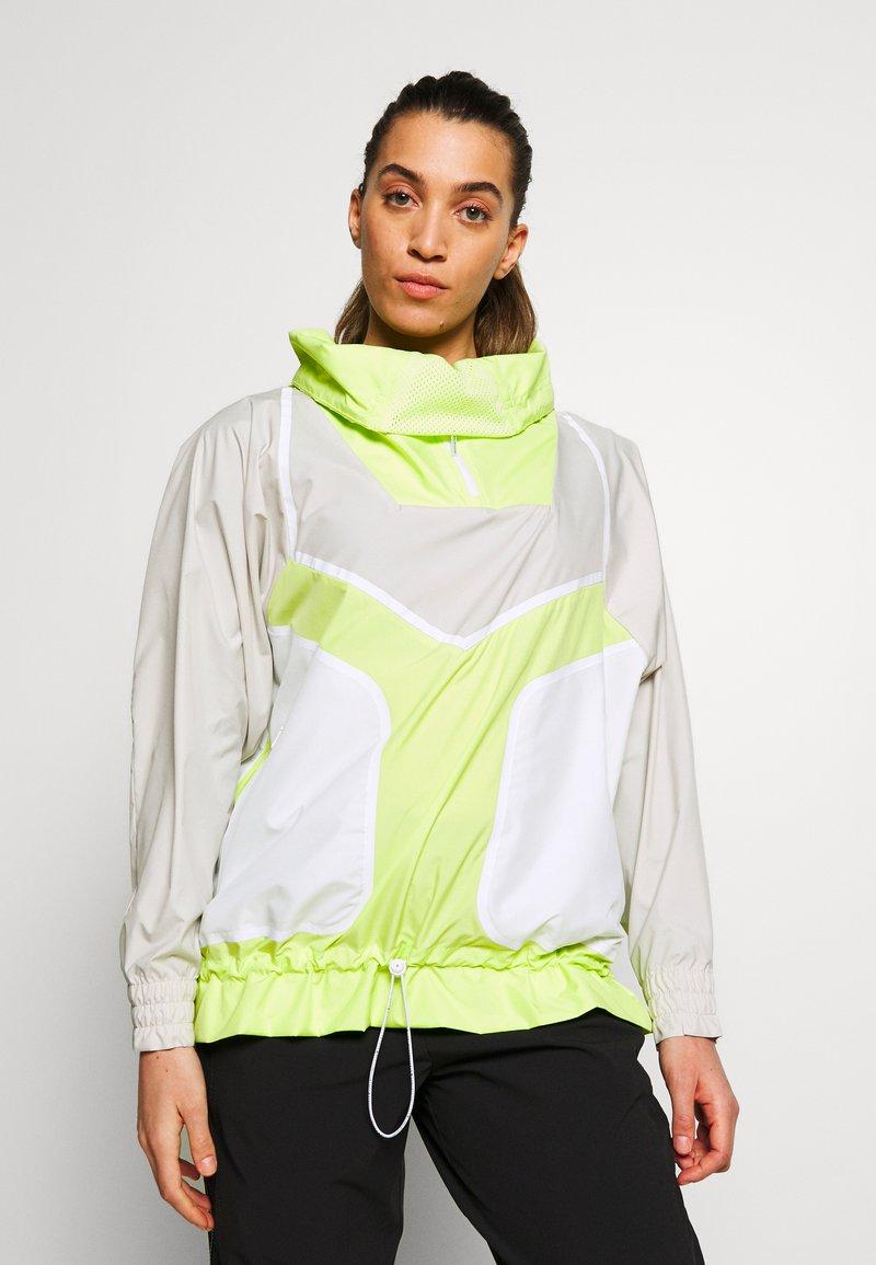 adidas by Stella McCartney - Vindjakke - tan/neon green