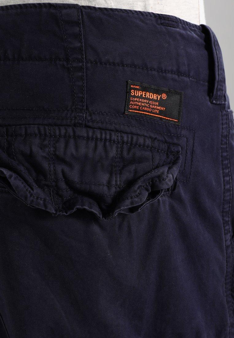 Superdry CORE LITE - Shorts - true indigo  Heren broeken Fkwyh