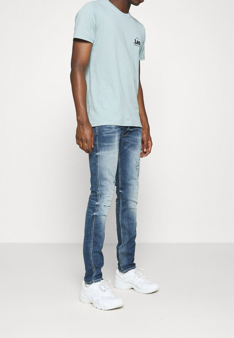 Replay - ANBASS AGED - Jeans slim fit - medium blue