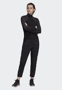 adidas Performance - HIKE TECHNICAL HIKING PANTS - Joggebukse - black - 1