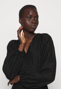 DESIGNERS REMIX - SONIA WRAP DRESS - Day dress - black - 4