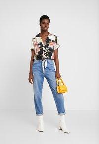 Mavi - STELLA ON MANNEQUIN - Straight leg jeans - light blue denim - 1
