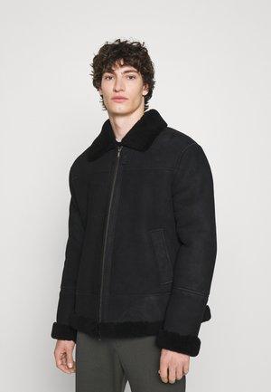 MONTONE - Leather jacket - black