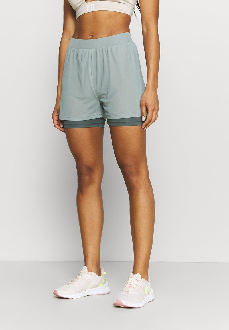 Even&Odd active - Sports shorts - green/blue-grey