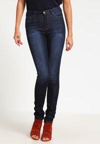 edc by Esprit - HIGH SKIN PANTS DENIM - Slim fit jeans - dark-blue denim - 0