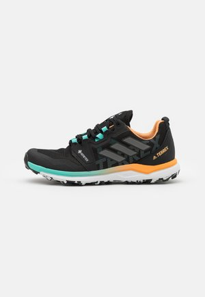 TERREX AGRAVIC GTX - Trail running shoes - core black/grey four/hazy orange