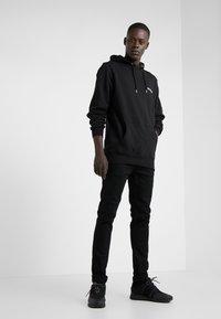 Han Kjøbenhavn - CASUAL HOODIE - Hoodie - black - 1