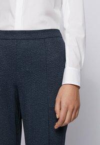 BOSS - TAHWENA - Trousers - patterned - 3