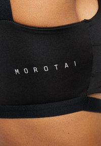 MOROTAI - NAKA CROPPED - Sports bra - black - 6