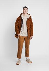 Levi's® - THERMORE PADDED - Lehká bunda - beige - 1
