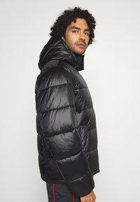 Champion Reverse Weave - HOODED JACKET - Winter jacket - black - 4