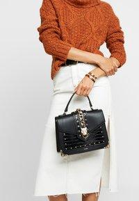 ALDO - VOALLAN - Handbag - black - 1