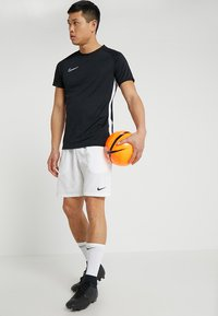 Nike Performance - DRY ACADEMY - T-shirt con stampa - black/white - 1