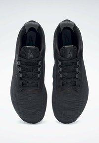 Reebok - NANO X1 GRIT SHOES - Neutral running shoes - black - 6
