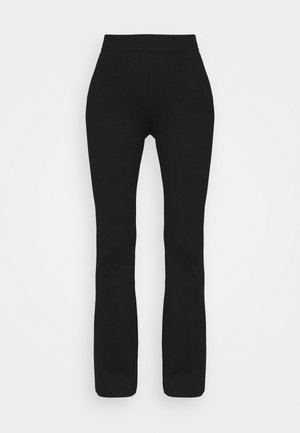 FLARED LOUNGE PANTS - Tracksuit bottoms - black