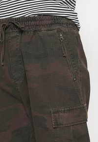Carhartt WIP - JOGGER COLUMBIA - Cargo trousers - camo provence rinsed - 4