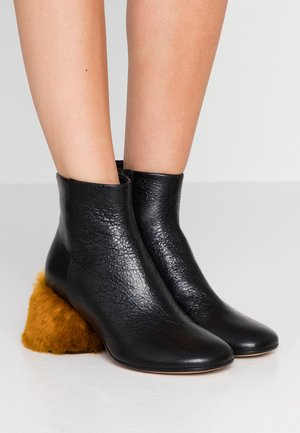 Ankle boots - black/golden yellow