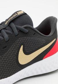 Nike Performance - REVOLUTION 5 UNISEX - Neutral running shoes - dark smoke grey/metallic gold/university red/yellow - 5