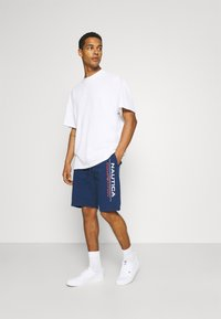 NAUTICA COMPETITION - DODGER - Tracksuit bottoms - navy - 1