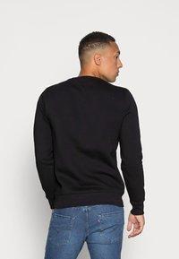 Tommy Jeans - NOVEL LOGO CREW - Sweatshirt - black - 2