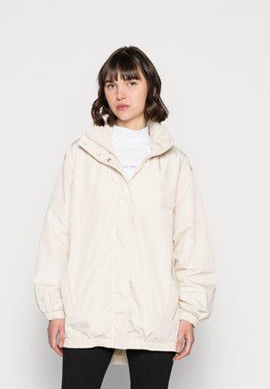 WAISTED WINDBREAKER - Summer jacket - beige