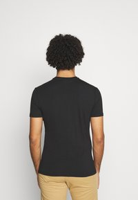 Tommy Jeans - STRETCH CHEST LOGO TEE  - Print T-shirt - black - 2