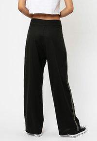 Religion - SUNRISE  - Trousers - jet black - 2