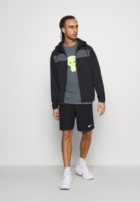 Under Armour - Windbreaker - black - 1