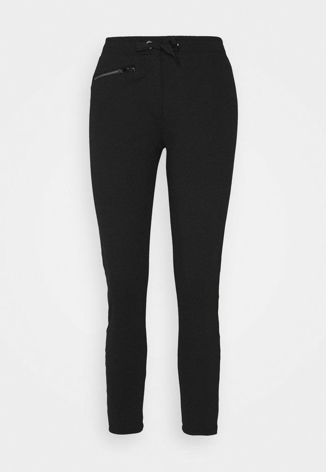 LUNAR TROUSER - Teplákové kalhoty - black