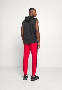 Ellesse - POTAT - Teplákové kalhoty - red - 2
