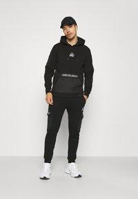 Kings Will Dream - RAFFORD OVERHEAD HOOD - Sweatshirt - jet black - 1