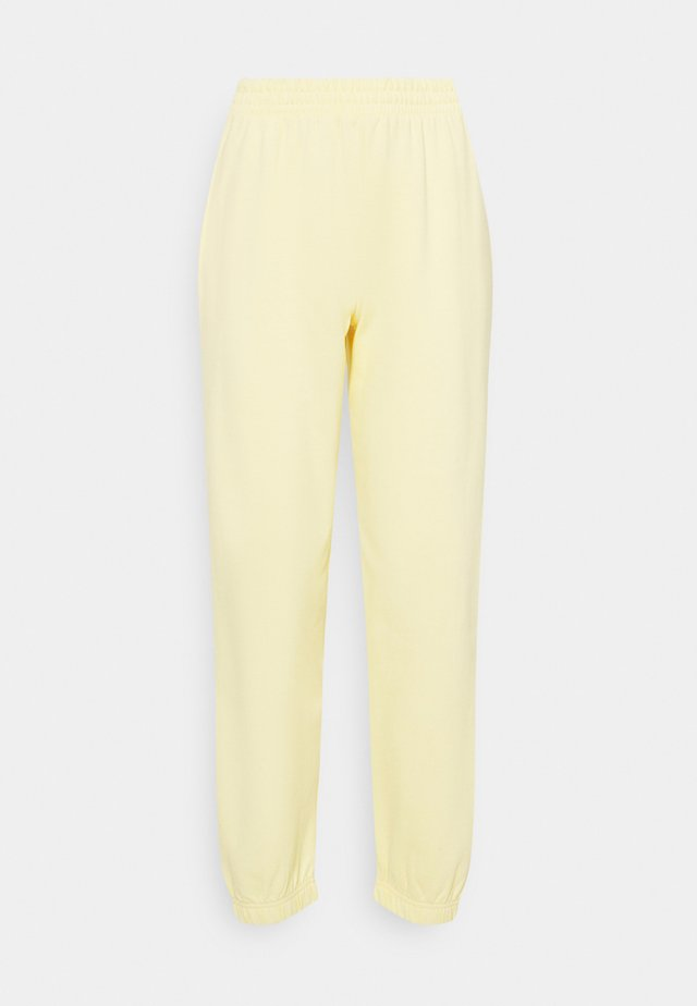 CUFFED - Spodnie treningowe - light yellow