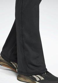 Reebok - PAUL POGBA BOOTCUT WORKOUT READY SPEEDWICK REECYCLED - Pantalones deportivos - black - 5