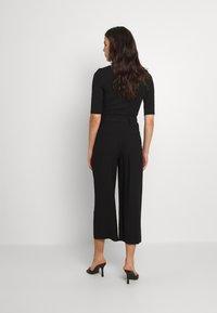 Vero Moda - VMORLA PANTS - Trousers - black - 2