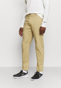 Nike Golf - DRY FIT PANT - Trousers - parachute beige - 0