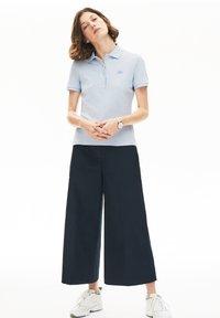 Lacoste - Polo shirt - bleu clair - 0