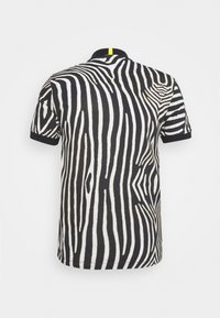 Lacoste - LACOSTE X NATIONAL GEOGRAPHIC - Polo shirt - black/white - 8