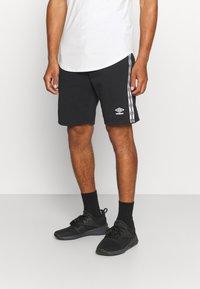 Umbro - TAPED SHORT LOOPBACK - Sports shorts - black - 0