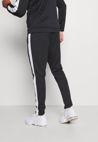 Under Armour - EMEA TRACK SUIT - Träningsset - black - 4