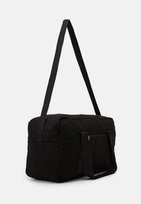 Reebok Classic - HOTEL GRIP UNISEX - Sports bag - black - 1