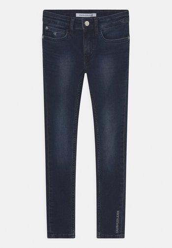 SUPER SKINNY - Jeans Skinny Fit - washed blue