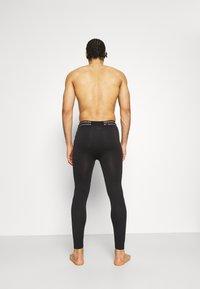 Puma - SEAMLESS BODYWEAR LONG - Leggings - black - 2