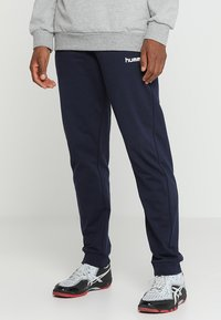 Hummel - HMLGO COTTON PANT - Trainingsbroek - marine - 0