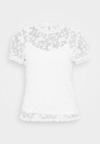 Blusa - off-white