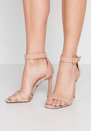 High heeled sandals - neutral