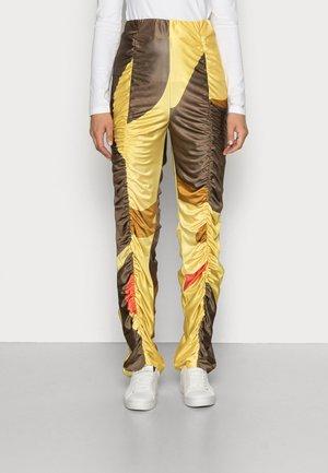 Spodnie materiałowe - bounce mustard